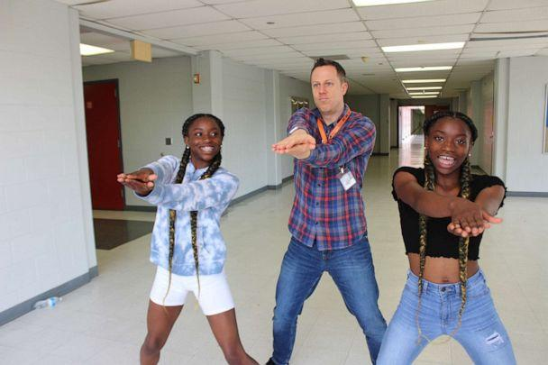 PHOTO: Dr. Trevor Boffone, a Spanish teacher at Bellaire High School in Bellaire, Texas, dances with his students, Takia and Talia Palmer. (Courtesy Allen Dao)