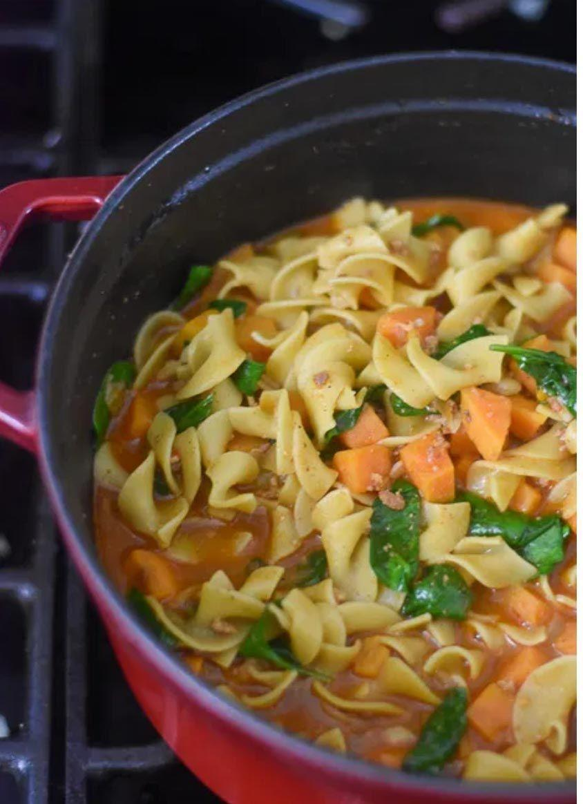 """<p>Warm, cozy, and hearty, this one-pot egg noodle soup is packed full of flavor from spiced-filled chorizo and veggies, including spinach and sweet potato.<strong><br></strong></p><p><strong>Get the recipe at <a href=""""https://www.dashofjazz.com/sweet-potato-chorizo-noodle-soup/"""" rel=""""nofollow noopener"""" target=""""_blank"""" data-ylk=""""slk:Dash of Jazz"""" class=""""link rapid-noclick-resp"""">Dash of Jazz</a>.</strong> </p>"""