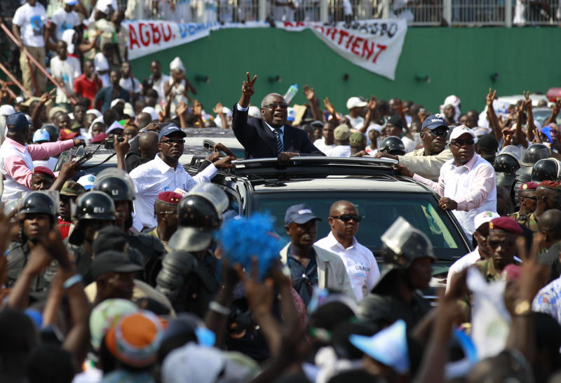Incumbent President Laurent Gbagbo, centre, gestures to supporters from his car as he arrives at his final campaign rally in Abidjan, Ivory Coast, Friday, Oct. 29, 2010, on the last day of campaigning ahead of Sunday's presidential election. Ivory Coast, the world's largest cocoa producer, has been overdue for an election since 2005 when President Gbagbo's term ended. Gbagbo is running ahead in polls, followed closely by former President Henri Konan Bedie and former Prime Minister Alassane Ouattara. (AP Photo/Rebecca Blackwell)