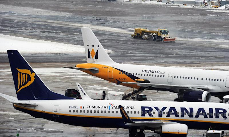 Monarch and Ryanair planes sit on the tarmac at Gatwick airport, West Sussex, on December 19, 2010