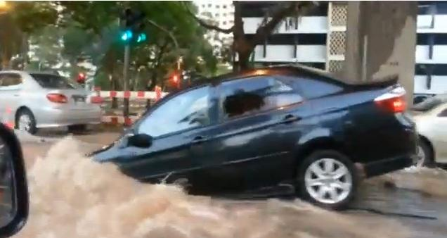 A Toyota Vios fell into a sinkhole at Keppel Road on Tuesday (YouTube screengrab)