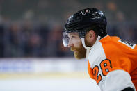 Philadelphia Flyers' Claude Giroux stands before a face-off during the second period of a preseason NHL hockey game against the New York Islanders, Tuesday, Sept. 28, 2021, in Philadelphia. (AP Photo/Matt Slocum)