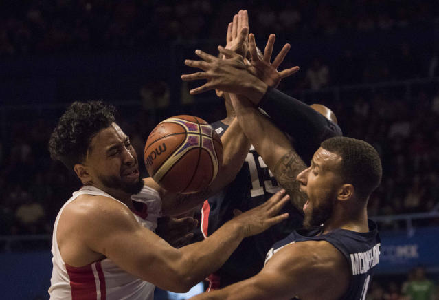 Mexico's Gabriel Giron, left, fights for the ball with U.S. player Trey McKinney during the first quarter of a regular season FIBA basketball World Cup qualifier in Mexico City, Thursday, June 28, 2018. (AP Photo/Christian Palma)