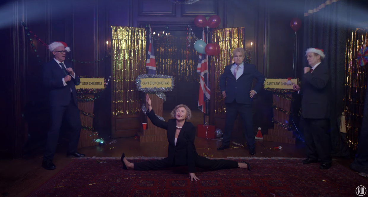 Theresa May also makes an appearance. (YouTube/Robbie Williams).