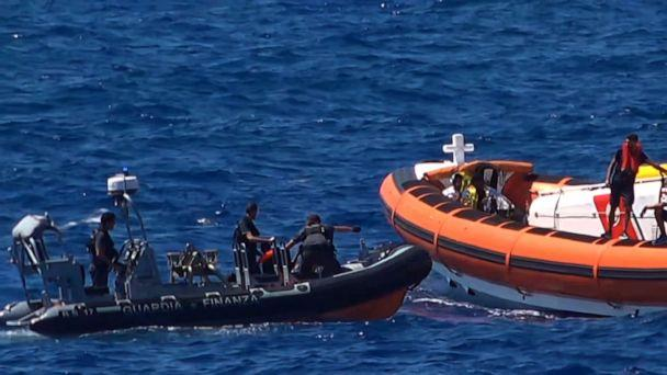 PHOTO: Migrants are rescued by NGO Proactiva Open Arms charity after throwing themselves in the water to try and swim to the nearby Italian island of Lampedusa, Aug. 20, 2019. (AFP/Getty Images)