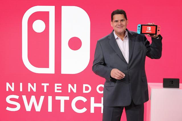 Nintendo of America President Reggie Fils-Aimé holds the popular Switch console.