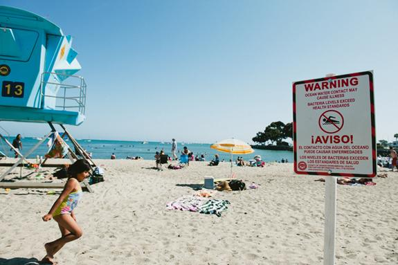 A warning sign at Doheny Beach, Calif., advises beachgoers to beware of high bacteria levels.
