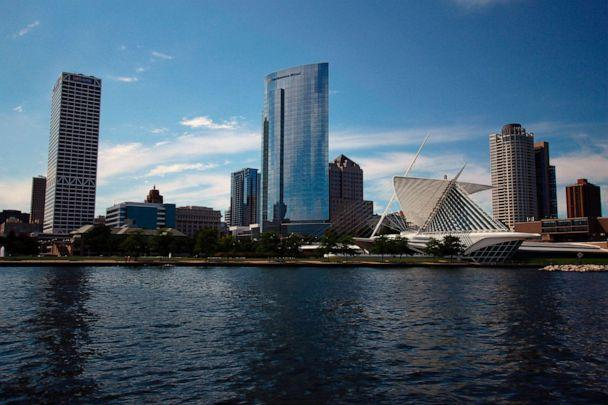 PHOTO: This Aug. 13, 2020 photo shows the skyline of downtown Milwaukee, the location of a scaled down Democratic National Convention. About 50,000 visitors were expect to inject about $250 million into the economy of the key battleground state. (Carrie Antlfinger/AP)