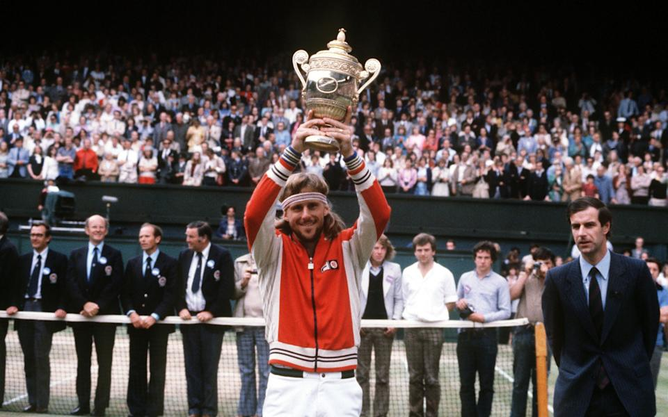 Bjorn Borg lifting the 1980 Wimbledon trophy - GETTY IMAGES