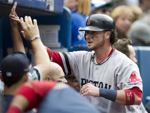 Boston Red Sox's Jarrod Saltalamacchia is congratulated by teammates after scoring the game-winning run during ninth inning of a baseball game against the Toronto Blue Jays in Toronto, Saturday, Sept. 15, 2012. (AP Photo/The Canadian Press, Frank Gunn)