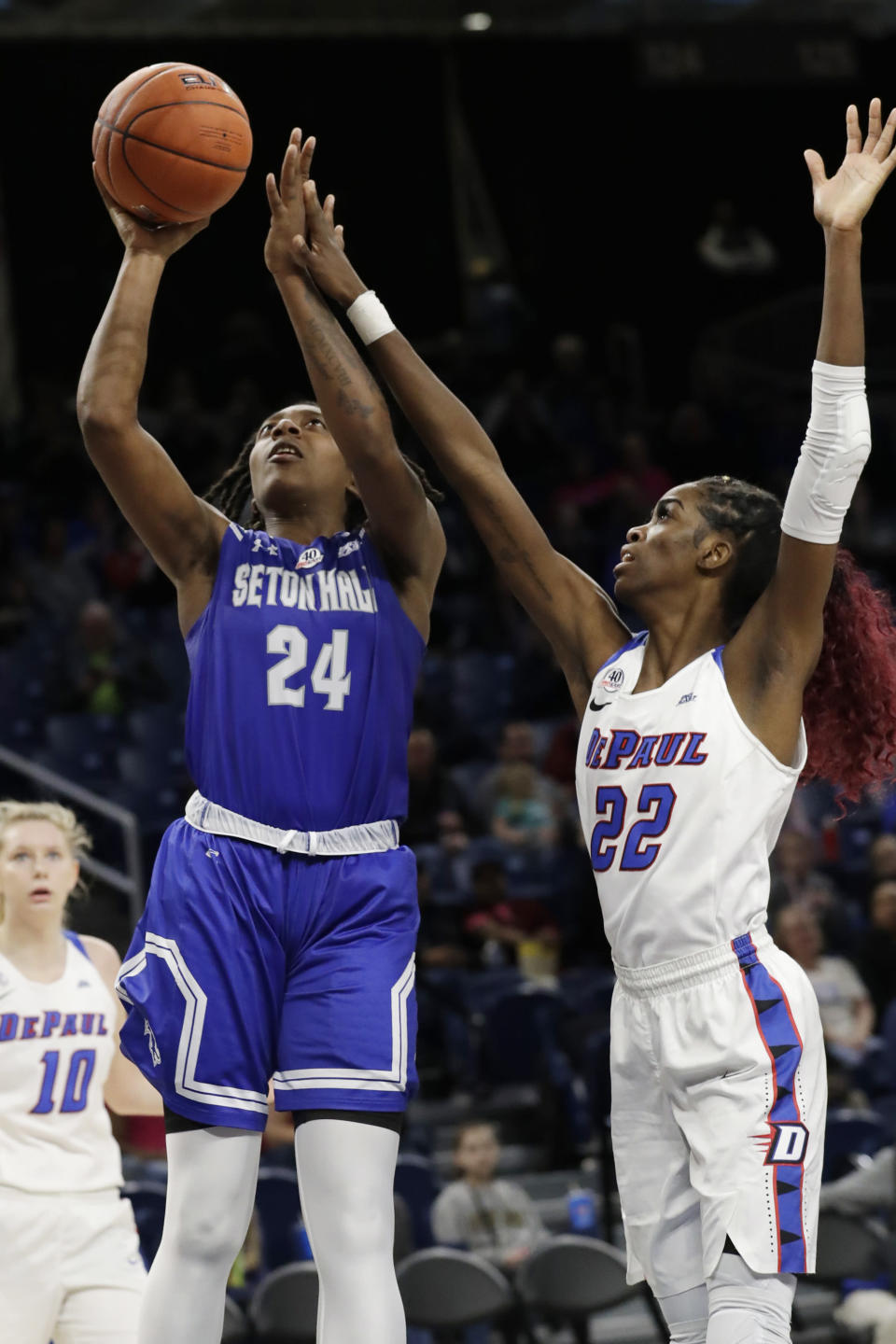 Seton Hall forward Shadeen Samuels, left, shoots against DePaul forward Chante Stonewall during the second half of an NCAA college basketball game in the Big East women's tournament semifinals, Sunday, March 8, 2020, in Chicago. (AP Photo/Nam Y. Huh)