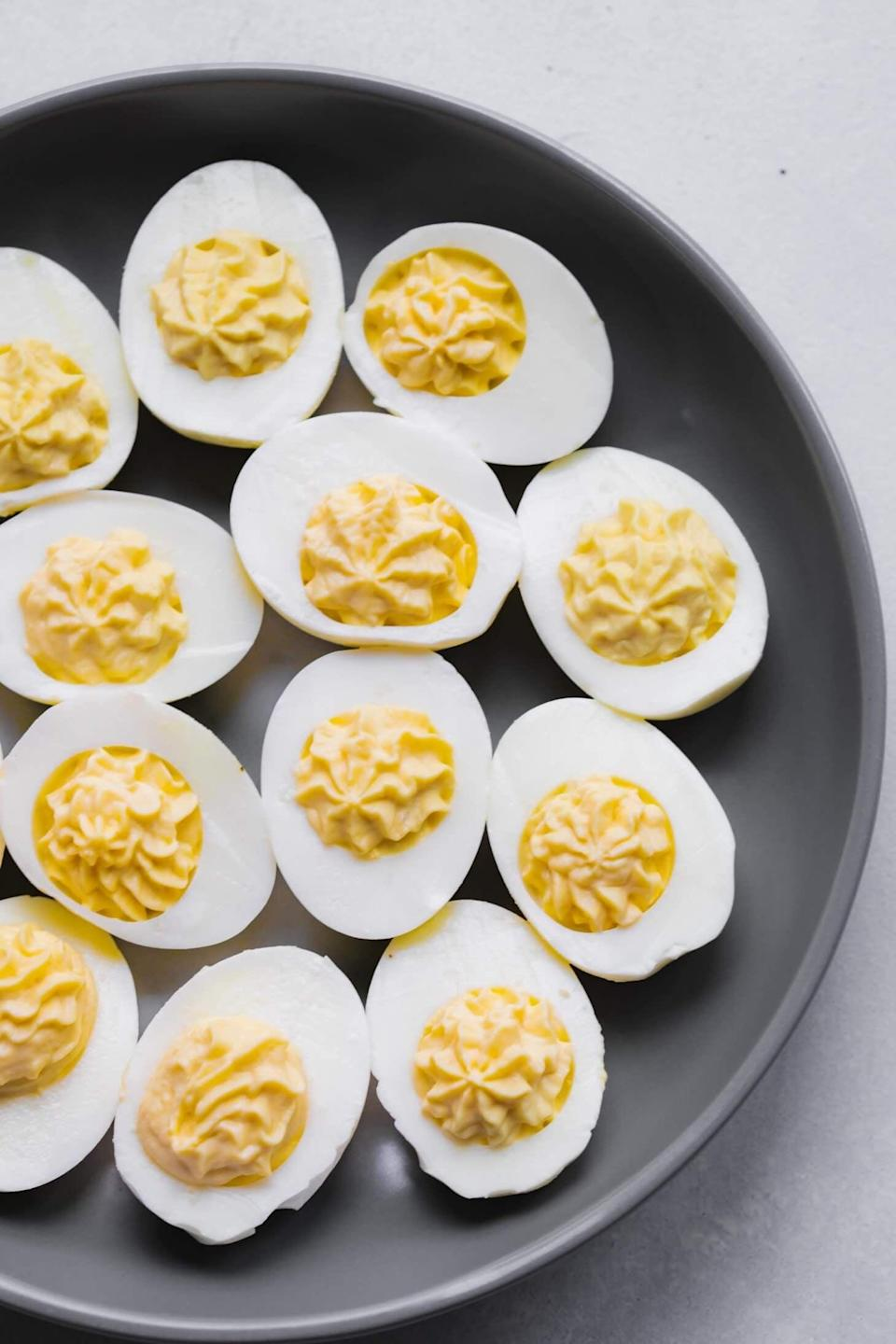"<p>This recipe delivers the tastiest, fastest, and easiest deviled eggs of them all. Just throw eggs in an Instant Pot and in less than 30 minutes, you'll have the side dish of your dreams. Cook up as many as you please, and enjoy a light appetizer before the main meal.</p> <p><strong>Get the recipe</strong>: <a href=""https://www.platingsandpairings.com/instant-pot-deviled-eggs-easy-peel/"" class=""link rapid-noclick-resp"" rel=""nofollow noopener"" target=""_blank"" data-ylk=""slk:Instant Pot deviled eggs"">Instant Pot deviled eggs</a></p>"