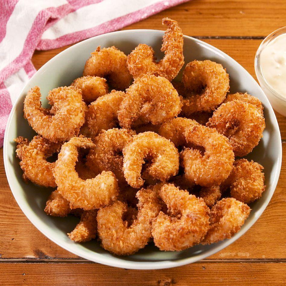 """<p>Popcorn prawns should be two things: Easy to make and easy to eat. With a homemade spicy tartare sauce, they are completely addictive and you'll want to just keep poppin' them in your mouth!</p><p>Get the <a href=""""https://www.delish.com/uk/cooking/recipes/a30166674/popcorn-shrimp-recipe/"""" rel=""""nofollow noopener"""" target=""""_blank"""" data-ylk=""""slk:Popcorn Prawns"""" class=""""link rapid-noclick-resp"""">Popcorn Prawns</a> recipe.</p>"""