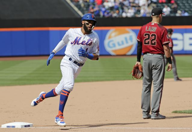 New York Mets' Amed Rosario (1) runs the bases after hitting a home run during the seventh inning of a baseball game as Arizona Diamondbacks third baseman Jake Lamb (22) looks away Sunday, May 20, 2018, in New York. (AP Photo/Frank Franklin II)