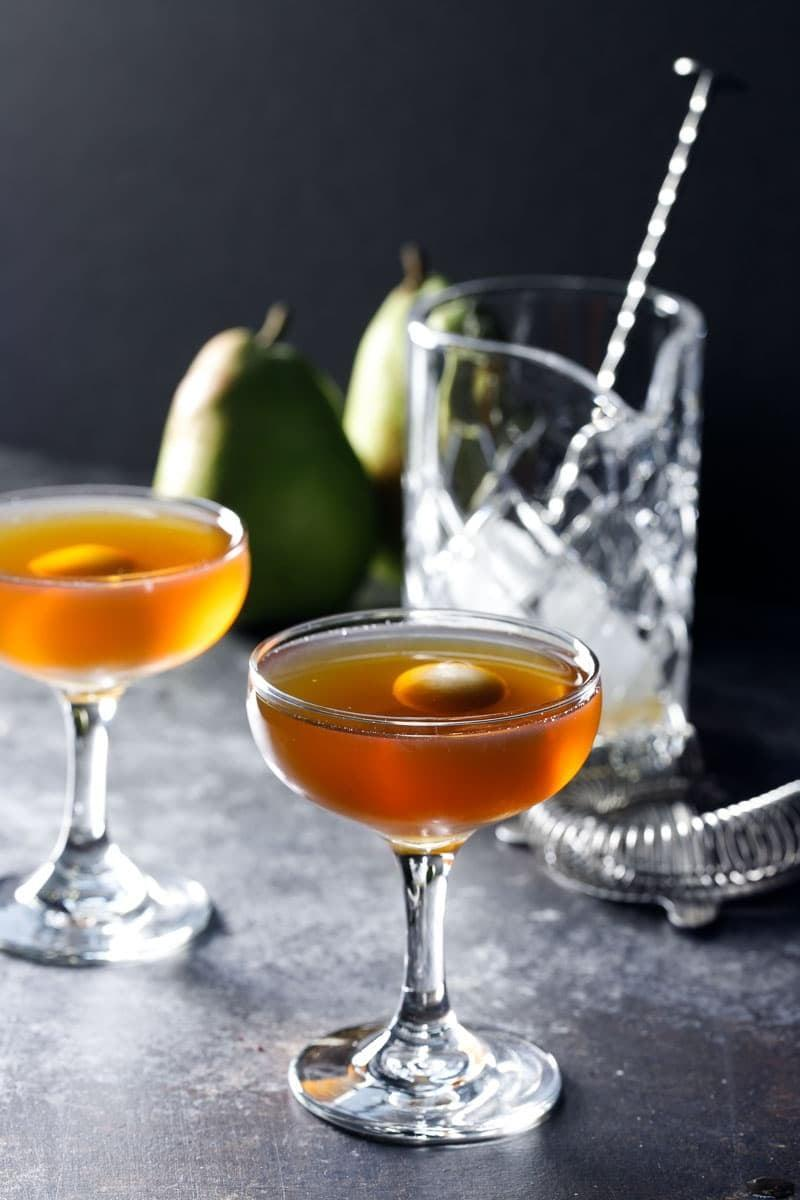 """<p>It's very on brand that New York's most searched cocktail is a Manhattan, wouldn't you say? Whiskey, sweet vermouth, and bitters make this drink all kinds of exciting. This pear Manhattan has a fruity spin to it, meaning you'll be sipping on it year round.</p> <p><strong>Get the recipe</strong>: <a href=""""https://www.popsugar.com/buy?url=https%3A%2F%2Fwww.loveandoliveoil.com%2F2018%2F02%2Fpear-manhattan.html&p_name=pear%20Manhattan&retailer=loveandoliveoil.com&evar1=yum%3Aus&evar9=47471653&evar98=https%3A%2F%2Fwww.popsugar.com%2Ffood%2Fphoto-gallery%2F47471653%2Fimage%2F47474654%2FNew-York-Manhattan&list1=cocktails%2Cdrinks%2Calcohol%2Crecipes&prop13=api&pdata=1"""" class=""""link rapid-noclick-resp"""" rel=""""nofollow noopener"""" target=""""_blank"""" data-ylk=""""slk:pear Manhattan"""">pear Manhattan</a></p>"""