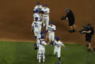 The Los Angeles Dodgers celebrate their 8-3 win against the Tampa Bay Rays in Game 1 of the baseball World Series Tuesday, Oct. 20, 2020, in Arlington, Texas. The Dodgers defeated the Rays 8-3 to lead the series 1-0 games. (AP Photo/David J. Phillip)