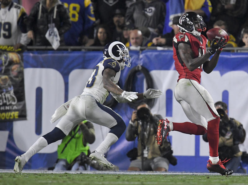 Atlanta Falcons wide receiver Julio Jones scores a touchdown in a win over the Rams. (AP)