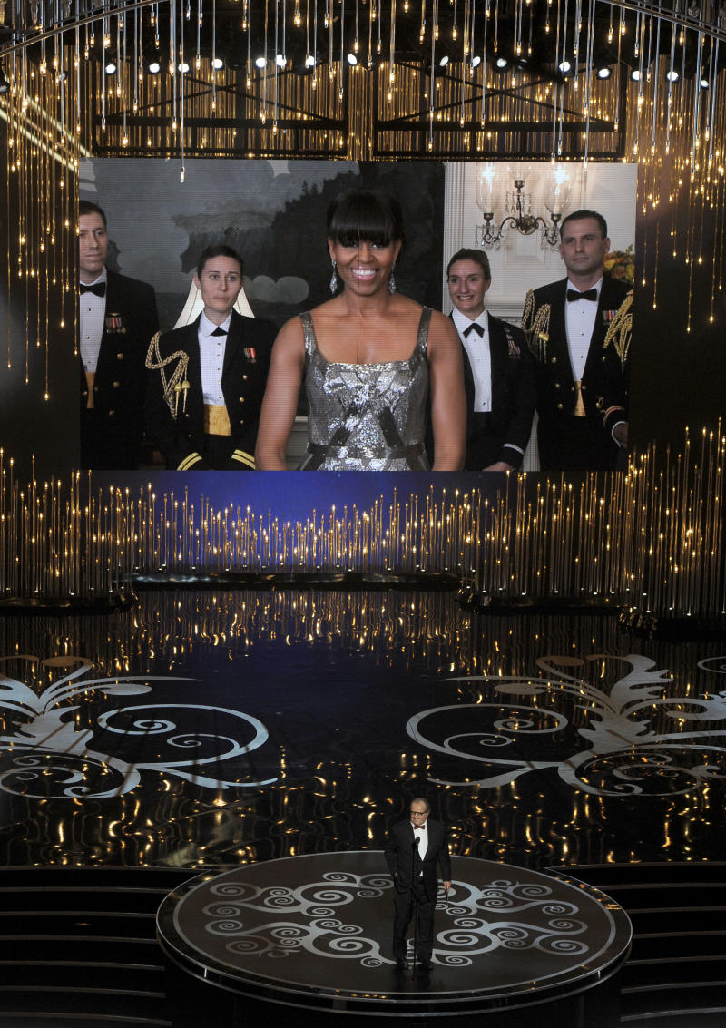 First lady Michelle Obama, appearing on screen, and actor Jack Nicholson present the award for best picture during the Oscars at the Dolby Theatre on Sunday Feb. 24, 2013, in Los Angeles.  (Photo by Chris Pizzello/Invision/AP)