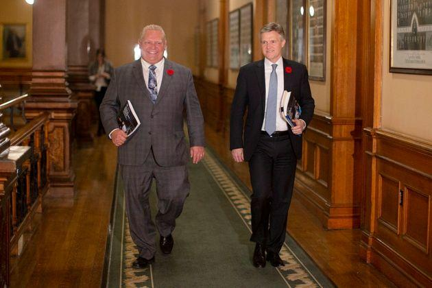 Ontario Premier Doug Ford and Finance Minister Rod Phillips walk to the legislative chamber to deliver the fall economic statement in Toronto on Nov. 6, 2019.