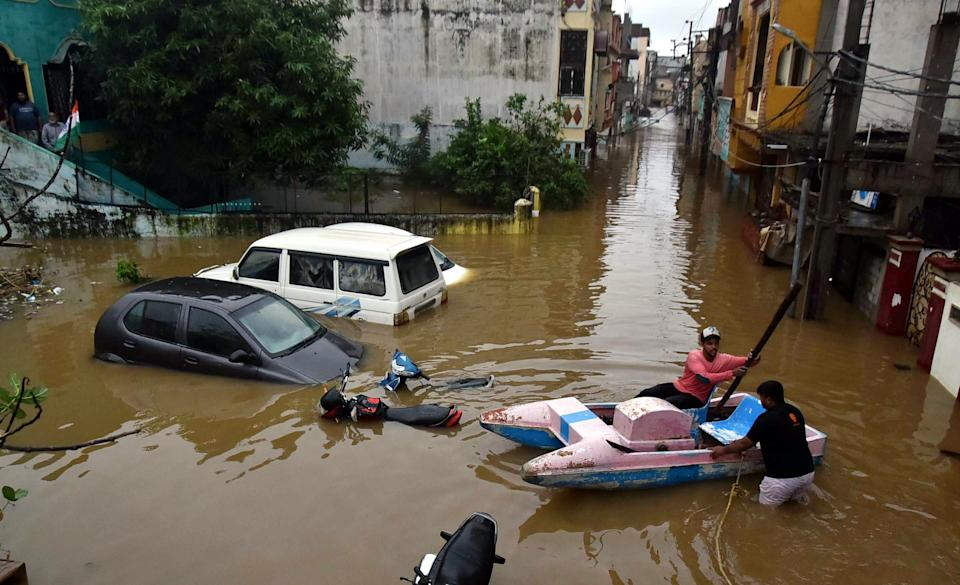 HYDERABAD, Oct. 14, 2020 -- People go out with a boat as roads are submerged after a heavy rainfall in Hyderabad, India, Oct. 14, 2020. (Photo by Str/Xinhua via Getty) (Xinhua/Xinhua via Getty Images)