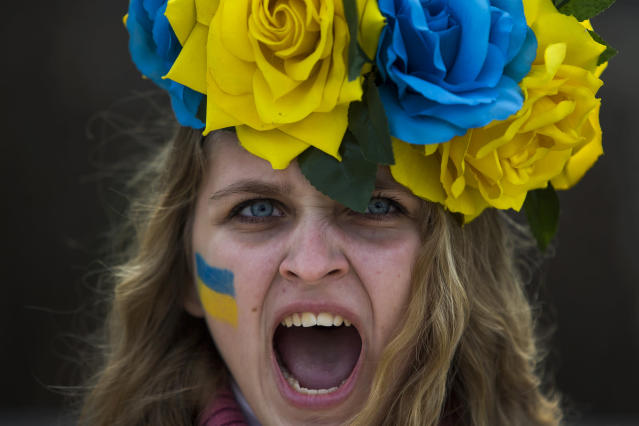 <p>A demonstrator shouts slogans in support of Ukraine's protests against Viktor Yanukovych's government in Madrid, Jan. 26, 2014. (AP Photo/Andres Kudacki) </p>