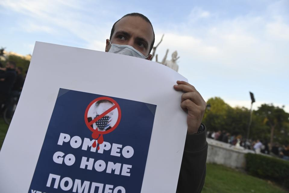 Protesters take part in a rally against the visit of the U.S. Secretary of State Mike Pompeo in Greece, in the northern city of Thessaloniki, on Monday, Sept. 28, 2020. Pompeo said Monday that Washington will use its diplomatic and military influence in the region to try to ease a volatile dispute between NATO allies Greece and Turkey over energy rights in the eastern Mediterranean. (AP Photo/Giannis Papanikos)