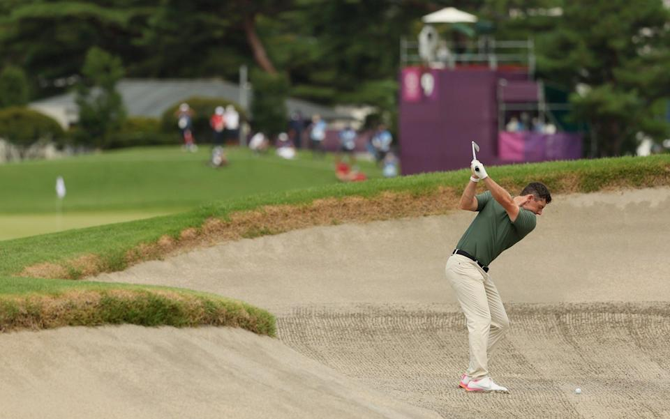 Rory McIlroy of Team Ireland plays a shot from a fairway bunker on the ninth hole - Getty Images