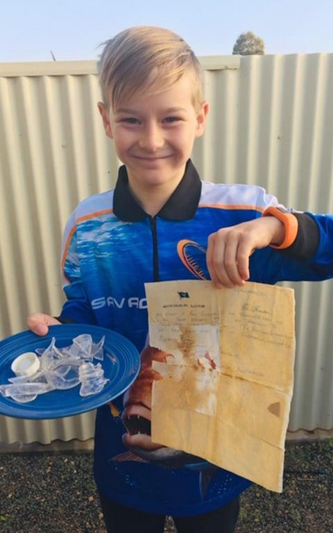 Jyah, 9, with the letter he found in a bottle - Credit: Mercury Press