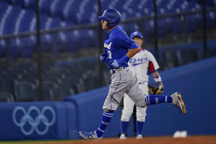 Israel's Ian Kinsler rounds the basses after hitting a home run in the third inning of a baseball game against South Korea at the 2020 Summer Olympics, Thursday, July 29, 2021, in Yokohama, Japan. (AP Photo/Sue Ogrocki)