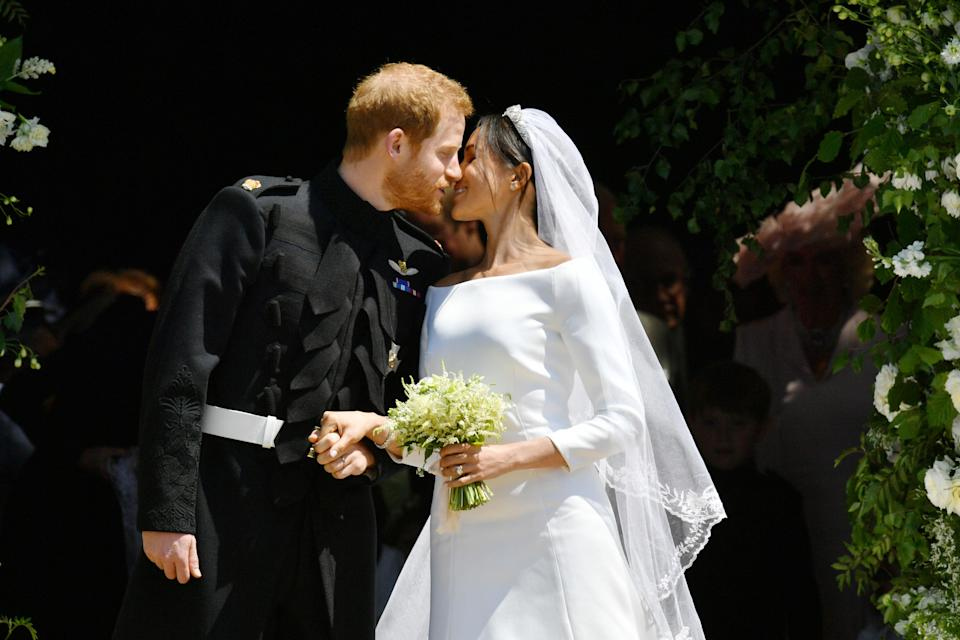 Harry and Meghan share their first kiss as a married couple. [Photo: PA]