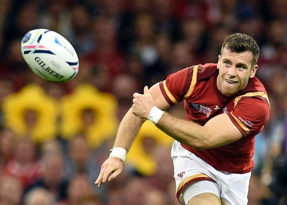 Wales' Gareth Davies passes during the Rugby World Cup Pool A match against Uruguay at the Millennium Stadium on September 20, 2015 (AFP Photo/Martin Bureau)