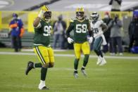 Green Bay Packers' Kingsley Keke reacts after sacking Philadelphia Eagles' Carson Wentz during the first half of an NFL football game Sunday, Dec. 6, 2020, in Green Bay, Wis. (AP Photo/Mike Roemer)