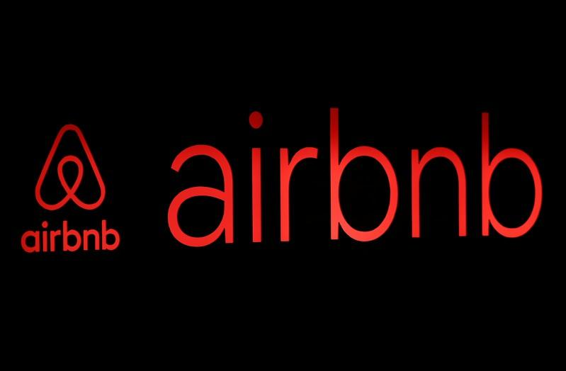 The logos of Airbnb are displayed at an Airbnb event in Tokyo