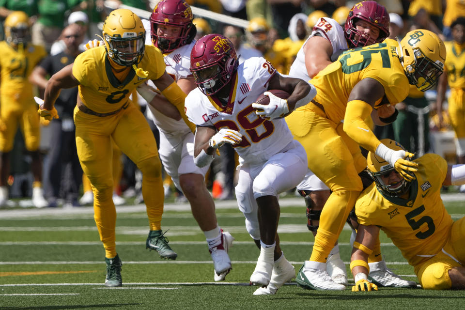 Iowa State running back Breece Hall (28) carries the ball against Baylor during the first half of an NCAA college football game, Saturday, Sept. 25, 2021, in Waco, Texas. (AP Photo/Jim Cowsert)
