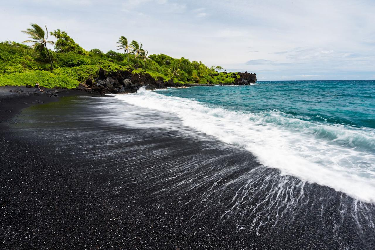 "<p>The Big Island is home to a variety of colourful sandy beaches from white sands to green sands, but one of its most famous is the <a rel=""nofollow"" href=""http://www.gohawaii.com/big-island/regions-neighborhoods/kau/punaluu-black-sand-beach/"">Punalu'u Black Sand Beach</a> found on the southeastern Kau coast. Swimming conditions aren't ideal here, but you may be able to spot sea turtles lounging on the sand. </p><p><a rel=""nofollow"" href=""https://www.tripadvisor.com/Attraction_Review-g60602-d109631-Reviews-Punaluu_Black_Sand_Beach-Pahala_Island_of_Hawaii_Hawaii.html"">Learn More</a></p>"