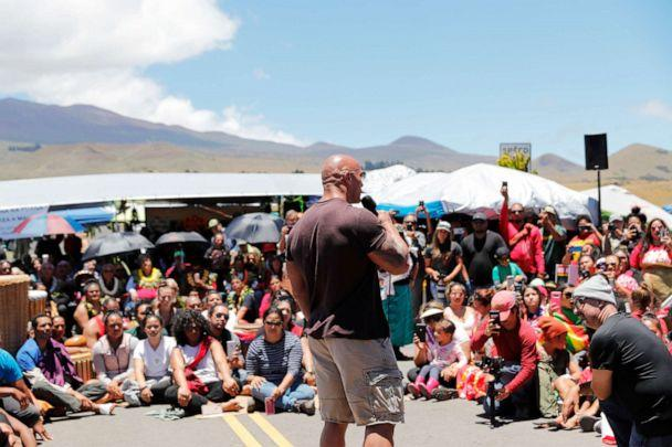 PHOTO: 'The Rock' Johnson talks to opponents of the TMT telescope during a visit to the protest site blocking the construction of the giant telescope on July 24, 2019, at the base of Mauna Kea on Hawaii Island. (Jamm Aquino/Honolulu Star-Advertiser via AP)