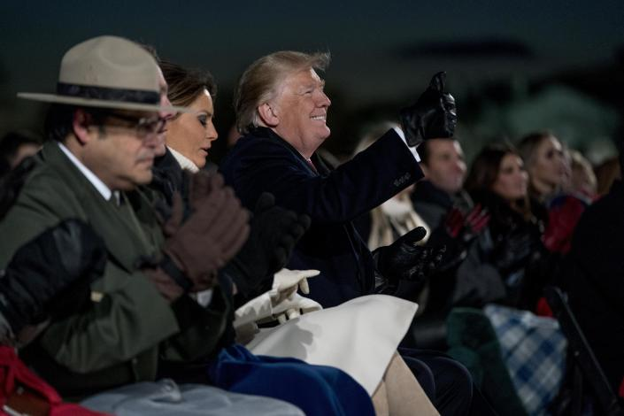 President Donald Trump, accompanied by first lady Melania Trump gives a thumbs up to a performer during the National Christmas Tree lighting ceremony at the Ellipse near the White House in Washington, Wednesday, Nov. 28, 2018. (Photo: Andrew Harnik/AP)