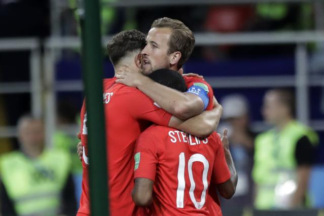 <p>John Stones and Raheem Sterling are the first to congratulate Kane on sixth goal of the World Cup </p>