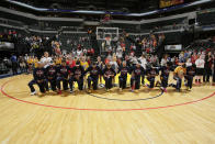 The Indiana Fever kneel during the National Anthem before the game against the Phoenix Mercury during Round One of the 2016 WNBA Playoffs on September 21, 2016 at Bankers Life Fieldhouse in Indianapolis, Indiana. (Photo by Ron Hoskins/NBAE via Getty Images)
