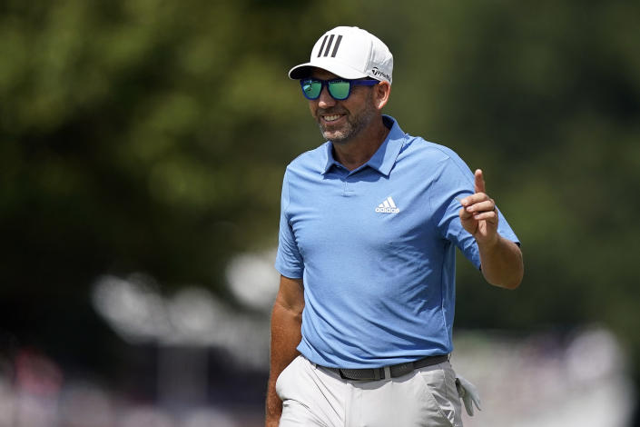 Sergio Garcia, of Spain, waves to the crowd in celebration after he made an eagle on the first hole during the first round of the Tour Championship golf tournament, Thursday, Sept. 2, 2021, at East Lake Golf Club in Atlanta. (AP Photo/Brynn Anderson)