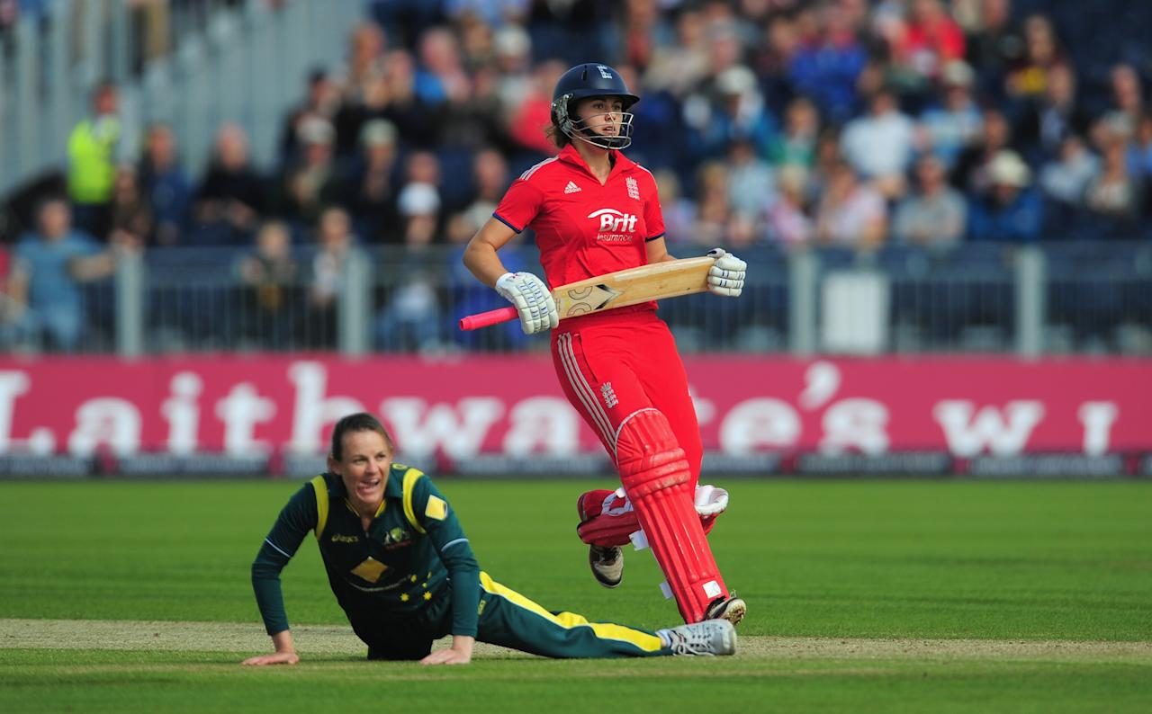 CHESTER-LE-STREET, ENGLAND - AUGUST 31:  England batsman Natalie Sciver scores the winning runs as Erin Osbourne looks on during the Women's Ashes Series - 3rd NatWest T20 between England Women and Australia Women at Emirates Durham ICG on August 31, 2013 in Chester-le-Street, England.  (Photo by Stu Forster/Getty Images)