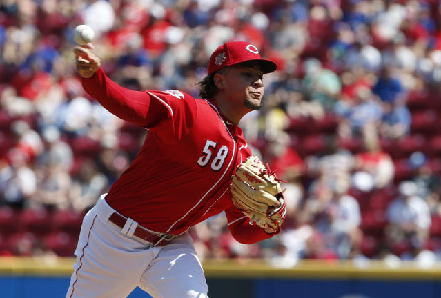 Cincinnati Reds starting pitcher Luis Castillo (58) throws against the Chicago Cubs during the first inning of a baseball game, Saturday, June 29, 2019, in Cincinnati. (AP Photo/Gary Landers)
