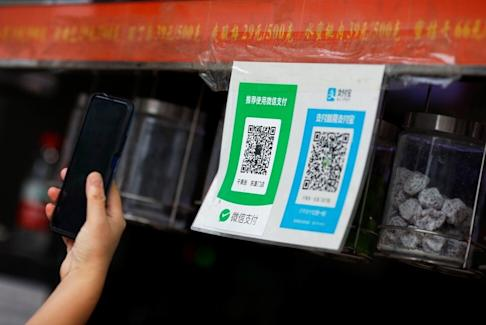 QR codes of the digital payment services WeChat Pay and Alipay are seen at a shop in Beijing, on August 6, 2020. Photo: Reuters
