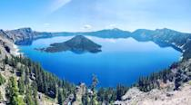 <p>Panoramic view of Crater Lake (which is literally a lake in a volcanic crater) atop the Cascade Mountain Range in Oregon, USA.</p>