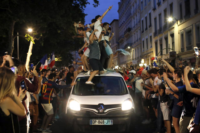 <p>French soccer fans,standing atop a car, celebrate their team victory after watching a live broadcast of the semifinal match between France and Belgium at the 2018 soccer World Cup, in Lyon, central France,Tuesday July 10, 2018. France has advanced to the World Cup final for the first time since 2006 with a 1-0 win over Belgium. (AP Photo/Laurent Cipriani) </p>
