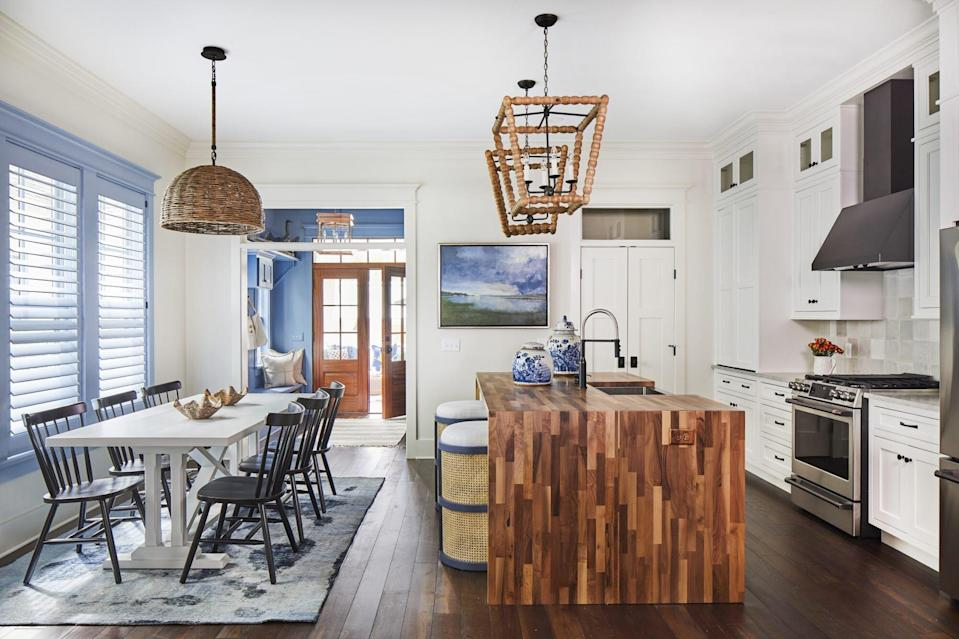 open floor plan kitchen and dining of the Loudon house plan in southern living inspired living community Habersham