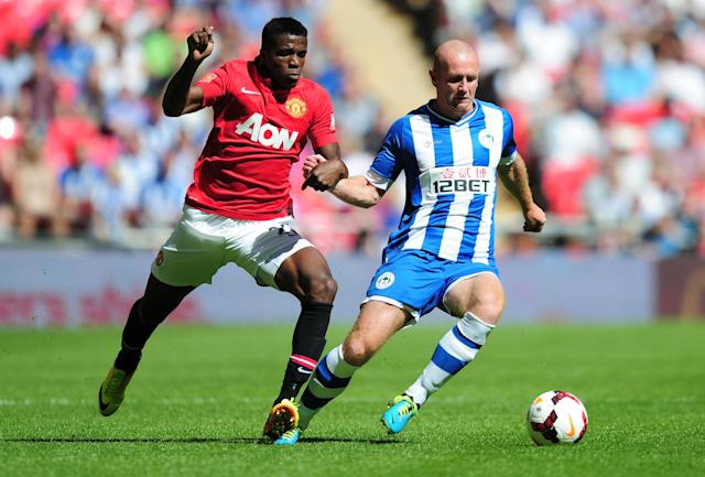 LONDON, ENGLAND - AUGUST 11: Wilfried Zaha of Manchester United and Stephen Crainey of Wigan Athletic tussle for the ball during the FA Community Shield match between Manchester United and Wigan Athletic at Wembley Stadium on August 11, 2013 in London, England. (Photo by Jamie McDonald/Getty Images)