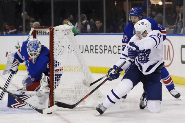 Toronto Maple Leafs' Zach Hyman, right, attempt to score as New York Rangers goaltender Alexandar Georgiev defends the net during the first period of an NHL hockey game Friday, Dec. 20, 2019, in New York. (AP Photo/Frank Franklin II)