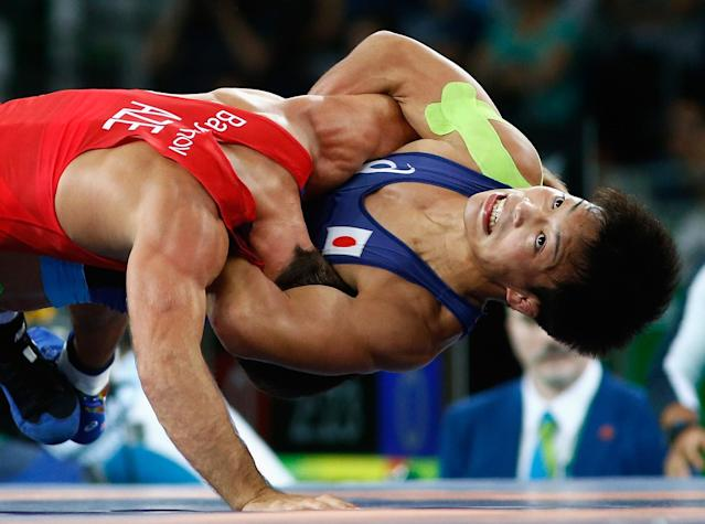 <p>Shinobu Ota of Japan competes against Rovshan Bayramov of Azerbaijan during the Men's 59 kg Greco-Roman Wrestling semifinal on Day 9 of the Rio 2016 Olympic Games at the Carioca Arena 2 on August 15, 2016 in Rio de Janeiro, Brazil. (Photo by Phil Walter/Getty Images) </p>