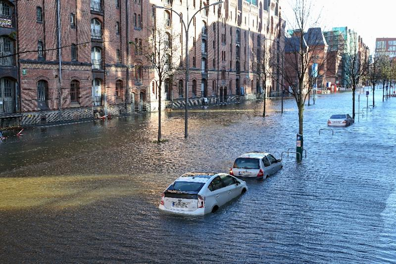 In Germany, the storms caused flooding in Hamburg, where waters rose up around the city's historic fishmarket and in the HafenCity and Blankenese districts (AFP Photo/Bodo Marks)
